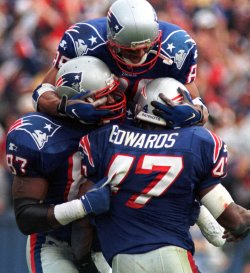 New England Patriot players celebrate in the end zone after Robert Edwards scored a touchdown