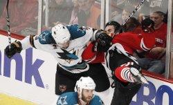Sharks Murray checks Blackhawks Ladd in Chicago