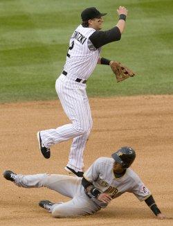 Rockies Shortstop Tulowitzki Leaps Over Pirates Cedeno in Denver