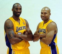 Kobe Bryant and Derek Fisher participate in Lakers' media day in El Segundo, California