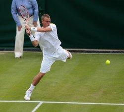 Lleyton Hewitt returns at 2013 Wimbledon Championships