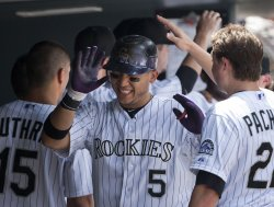 Rockies Gonzalez Congratulated in Dugout after Homer Against the Pirates in Denver