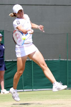 Justine Henin plays a forehand at the Wimbledon Championships
