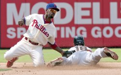 Philadelphia shortstop Jimmy Rollins tags Angel Pagan on an attempted steal in the 7th.