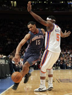 Charlotte Bobcats Gerald Henderson drives the ball by New York Knicks Bill Walker at Madison Square Garden in New York