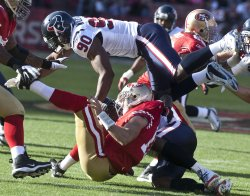 Huston's Antionio Smith sacks Alex Smith in San Francisco