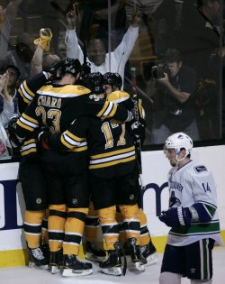 Bruins celebrate goal against Canucks in game 4 of the NHL Stanley Cup Finals in Boston, MA.
