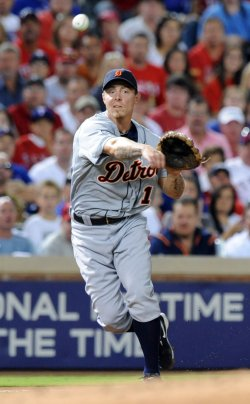 Tigers Inge throws out Rangers Napoli in game six of the ALCS in Texas