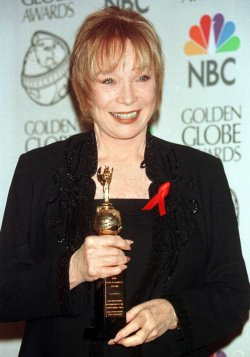 Shirley MacLaine poses backstage with the Cecil B. DeMille Award
