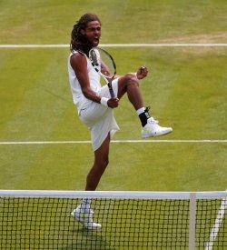 Dustin Brown celebrates at 2013 Wimbledon Championships
