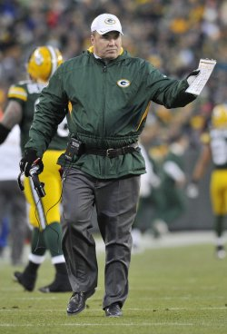 Packer coach McCarthy stands on sidelines against Raiders in Green Bay, Wisconsin