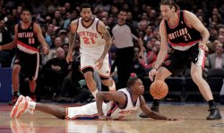 Portland Trail Blazers Fabricio Oberto (23) and New York Knicks Wilson Chandler (21) watch Toney Douglas at Madison Square Garden in New York