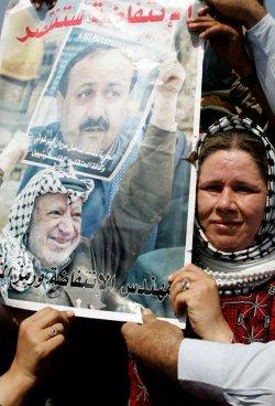FAWA BARGHOUTI, WIFE OF JAILED PALESTINIAN UPRISING LEADER MARWAN BARGHOUTI NEAR THE ISRAELI SETTlEMENT