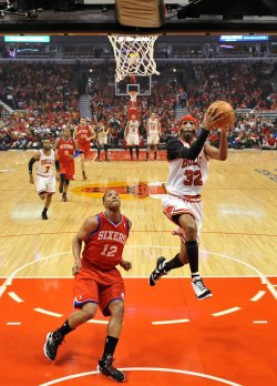 Bulls' Hamilton scores on 76ers' Turner during Playoff in Chicago