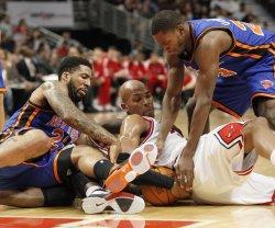 Knicks Chandler, Douglas and Bulls Gibson go for ball in Chicago