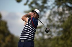 Phil Mickelson hits a tee shot during a Ryder Cup Practice Round