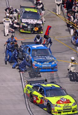 Mark Martin pulls into his pits in front of Martin Truex Jr and Jeff Gordon during the running of the NASCAR TUMS Fast Relief 500