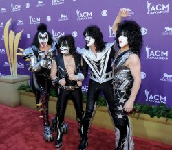 (L-R) Musicians Gene Simmons, Eric Singer, Tommy Thayer and Paul Stanley of the band KISS arrive at the Academy of Country Music Awards in Las Vegas