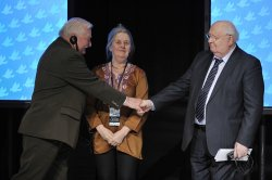 Gorbachev and Walesa shake hands at Peace Summit in Chicago