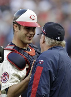Twins Mauer and Gardenhire celebrate win over Red Sox in Minneapolis