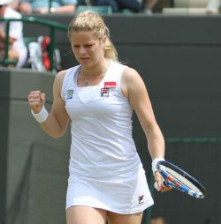 Kim Clijsters celebrates her win on the third day of Wimbledon.