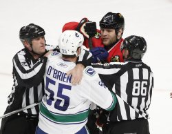 Canucks O'Brien and Blackhawks Eager scuffel in Chicago