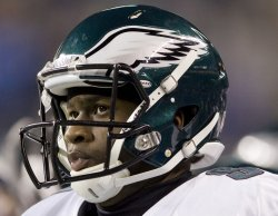 Philadelphia Eagles quarterback Vince Young watches from the sidelines after throwing a pass interception in the third during the quarter against the Seattle Seahawks.
