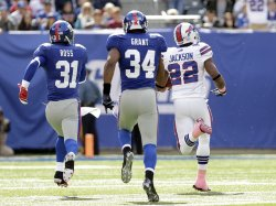 New York Giants Aaron Ross and Deon Grant chase Buffalo Bills Fred Jackson as he runs for an 80 yard touchdown at MetLife Stadium in New Jersey
