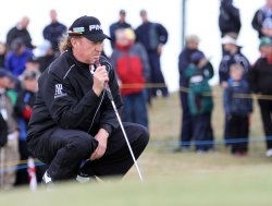 Jimenez lines up a putt on the 9th green during the Open Championship in England.