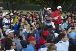 Phil Mickelson watches a tee shot during a Ryder Cup Practice Round