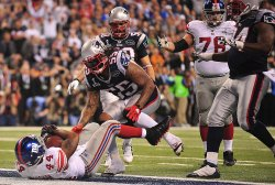 The Giants Bradshaw Scores the Game-Winning Touchdown Against the Patriiots during Super Bowl XLVI in Indianapolis