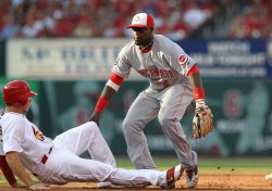 Cardinals Colby Rasmus is tagged out in St. Louis