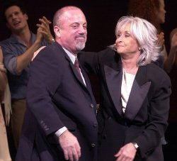 "Billy Joel musical ""Movin Out"" opens on Broadway"