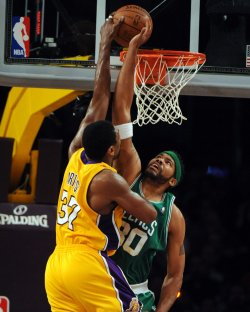Lakers' Ron Artist is dunks over Celtic's Wallace during NBA game in Los Angeles
