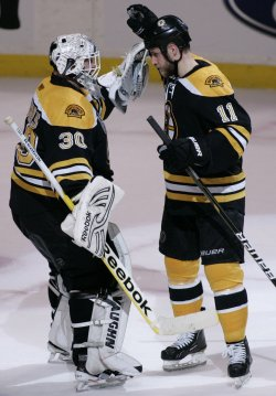 Bruins Thomas hugs Campbell after they beat Canucks in game 4 of the NHL Stanley Cup Finals in Boston, MA.