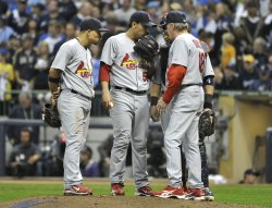 Cardinals' pitching coach Dave Duncan talks to pitcher Fernando Salas during game 6 of NLCS in Milwaukee, Wisconsin
