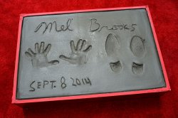 Mel Brooks places hands and footprints in wet cement at TCL Chinese Theatre in Los Angeles
