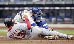Washington Nationals Rick Ankiel is tagged out at home plate by New York Mets Josh Thole on Opening Day at Citi Field in New York
