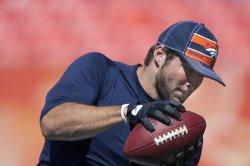 Denver Broncos Quarterback Tim Tebow Takes Reps on Receiving Pass