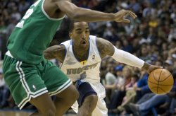 Nuggets Smith Drives Against Celtics Allen in Denver