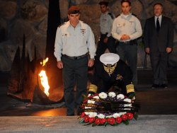 Chairman of the U.S. Joint Chiefs of Staff, Admiral Michael Mullen lays a wreath during a memorial ceremony at the Yad Vashem Holocaust Museum