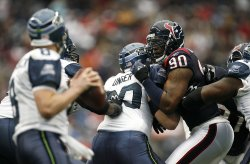 Houston Texans Mario Williams Closes in as he Looks to Put Pressure on Seattle Seahawks Matt Hasselbeck at Reliant Stadium in Houston