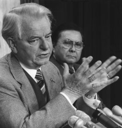 Senators Robert Byrd and Daniel Inouye unveil legislation on the Iran-Contra aid scandal