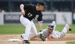 Boston Red Sox's Alex Gonzalez (R) slides safely into second base with a double against the Chicago White Sox in Chicago