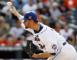 New York Mets starting pitcher Mike Pelfrey throws a pitch against the Arizona Diamondbacks at Citi Field in New York