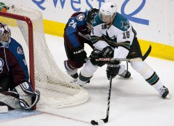 Sharks Heatley Takes a Shot Against Avalanche Goalie Anderson in Denver