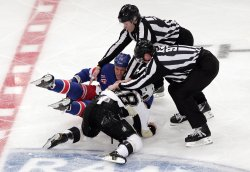 New York Rangers Sean Avery and Pittsburgh Penguins Tyler Kennedy fall to the ice while fighting at Madison Square Garden in New York