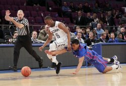DePaul Blue Demons Moses Morgan and Connecticut Huskies Kemba Walker at the NCAA Big East Men's Basketball Championships Finals in New York