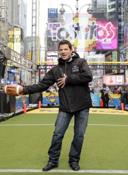 "Nick Lachey kicks a field goal at the ""Tostitos Fiesta in the Square"" in New York"