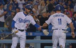 Dodgers' Logan Forsythe scores against Giants in Los Angeles